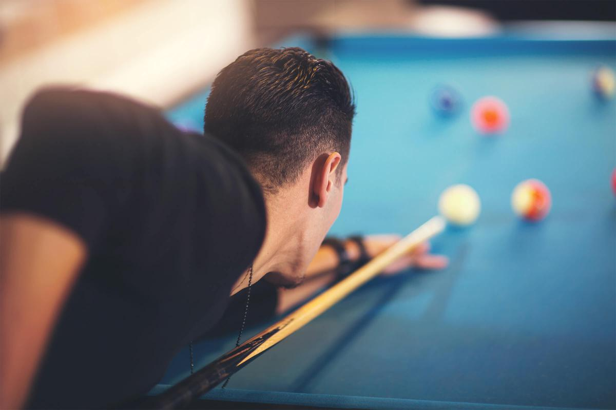 man playing pool iStock-636188860.jpg