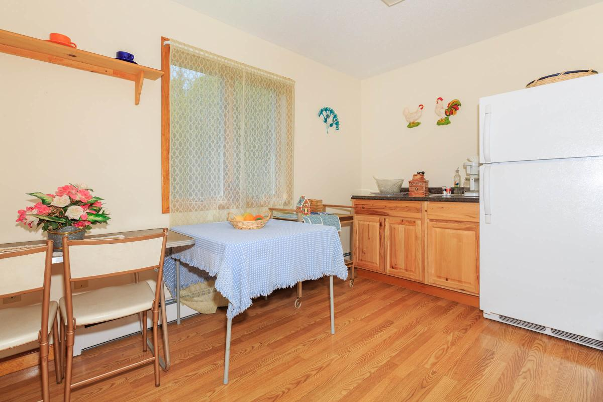 a kitchen with a wooden floor
