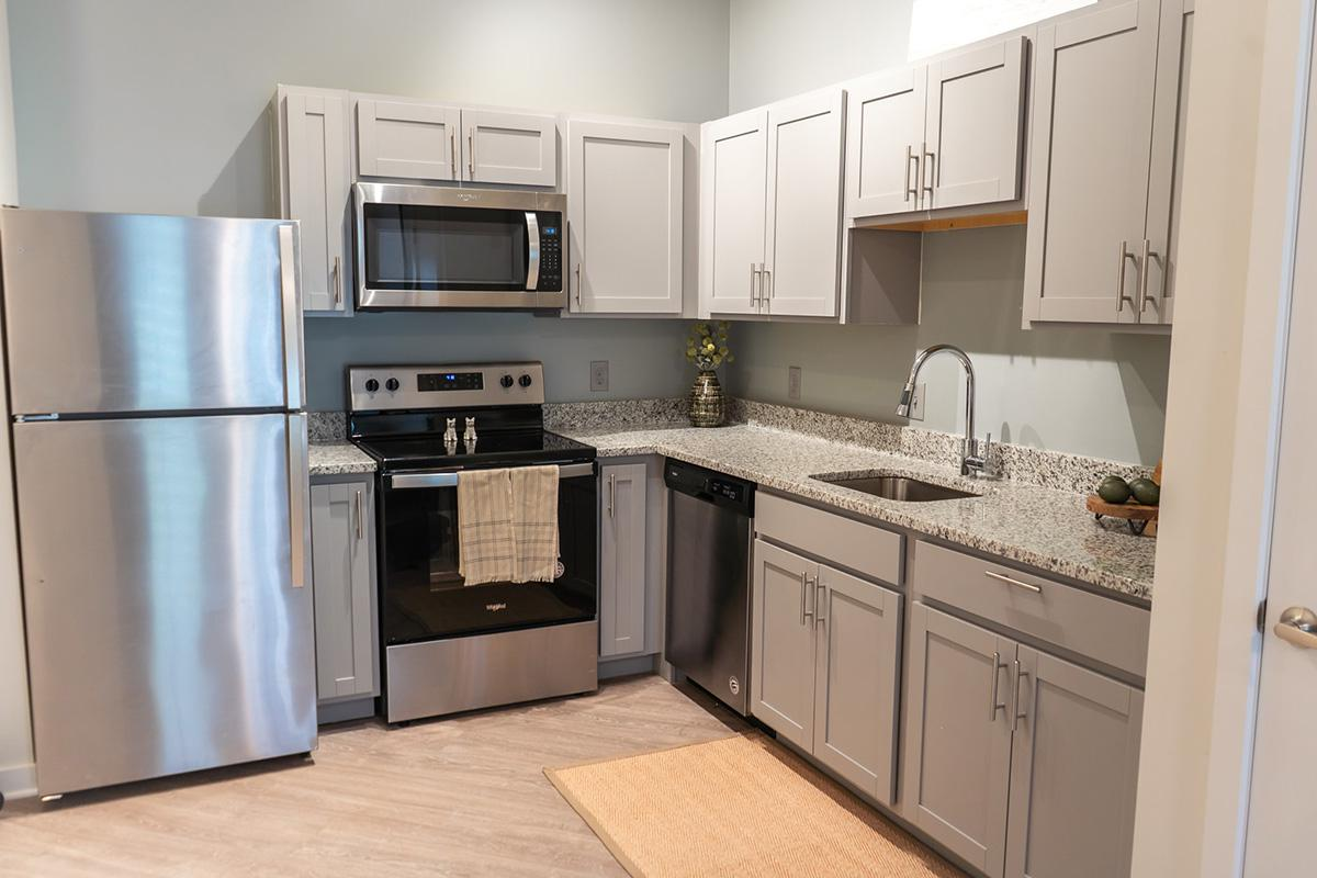 Open kitchen in studio apartment at the Lofts at Brentwood