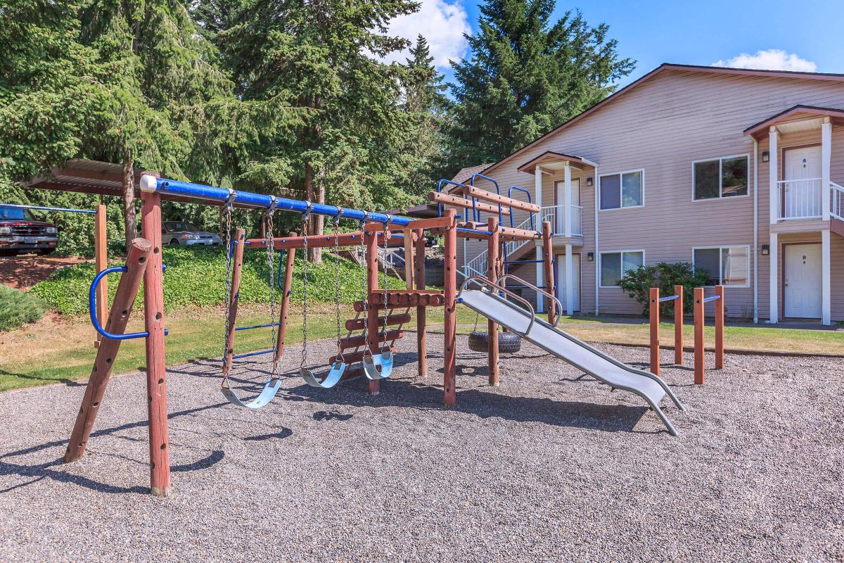 a playground in front of a house