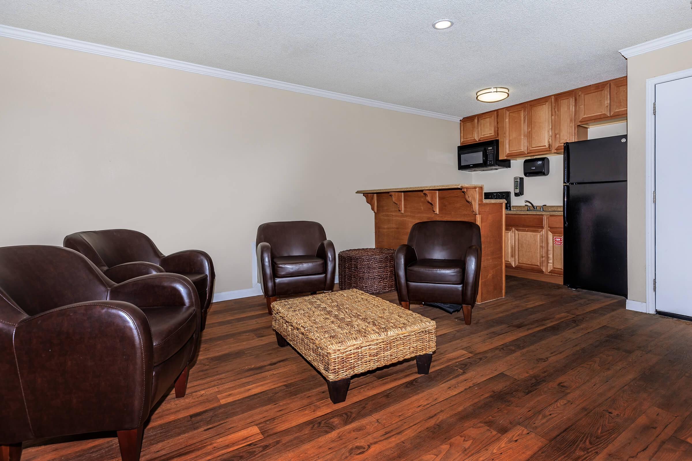 a living room filled with furniture and a tv