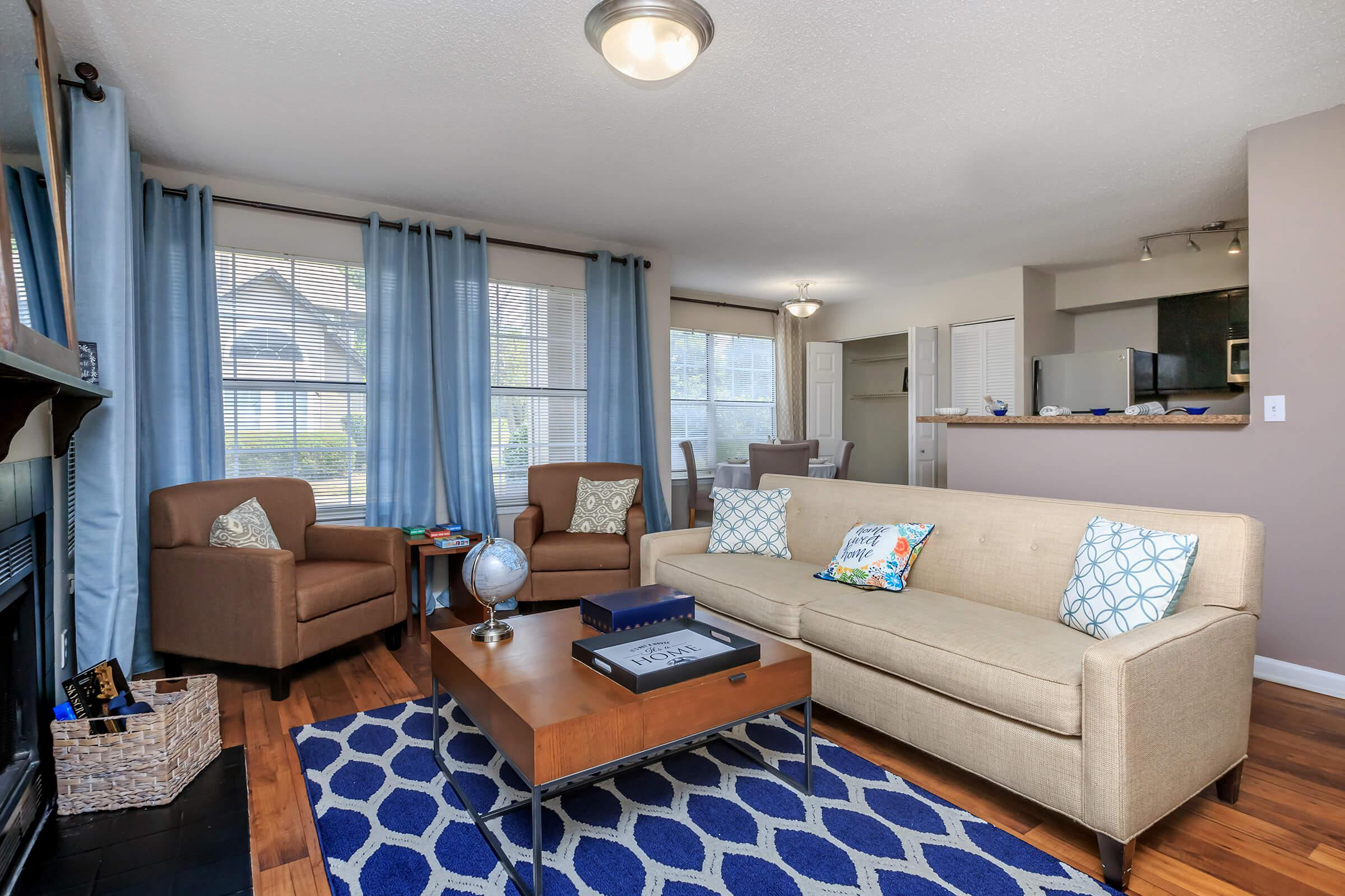 YOUR NEW LIVING ROOM AT SUMMERLAKE APARTMENTS