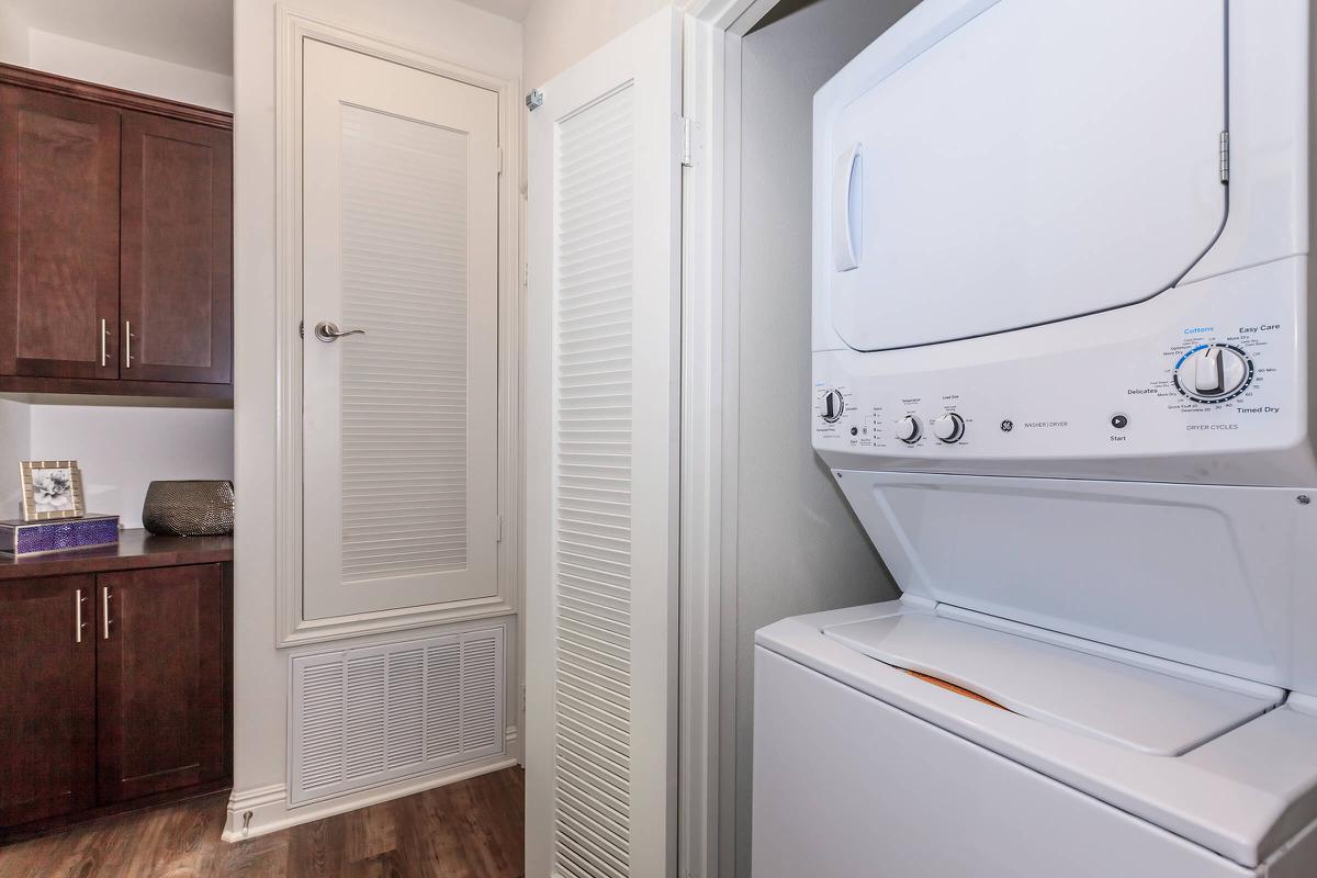 a white refrigerator freezer sitting next to a door