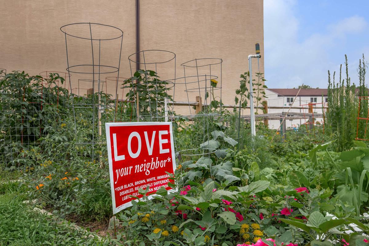 a sign in a garden