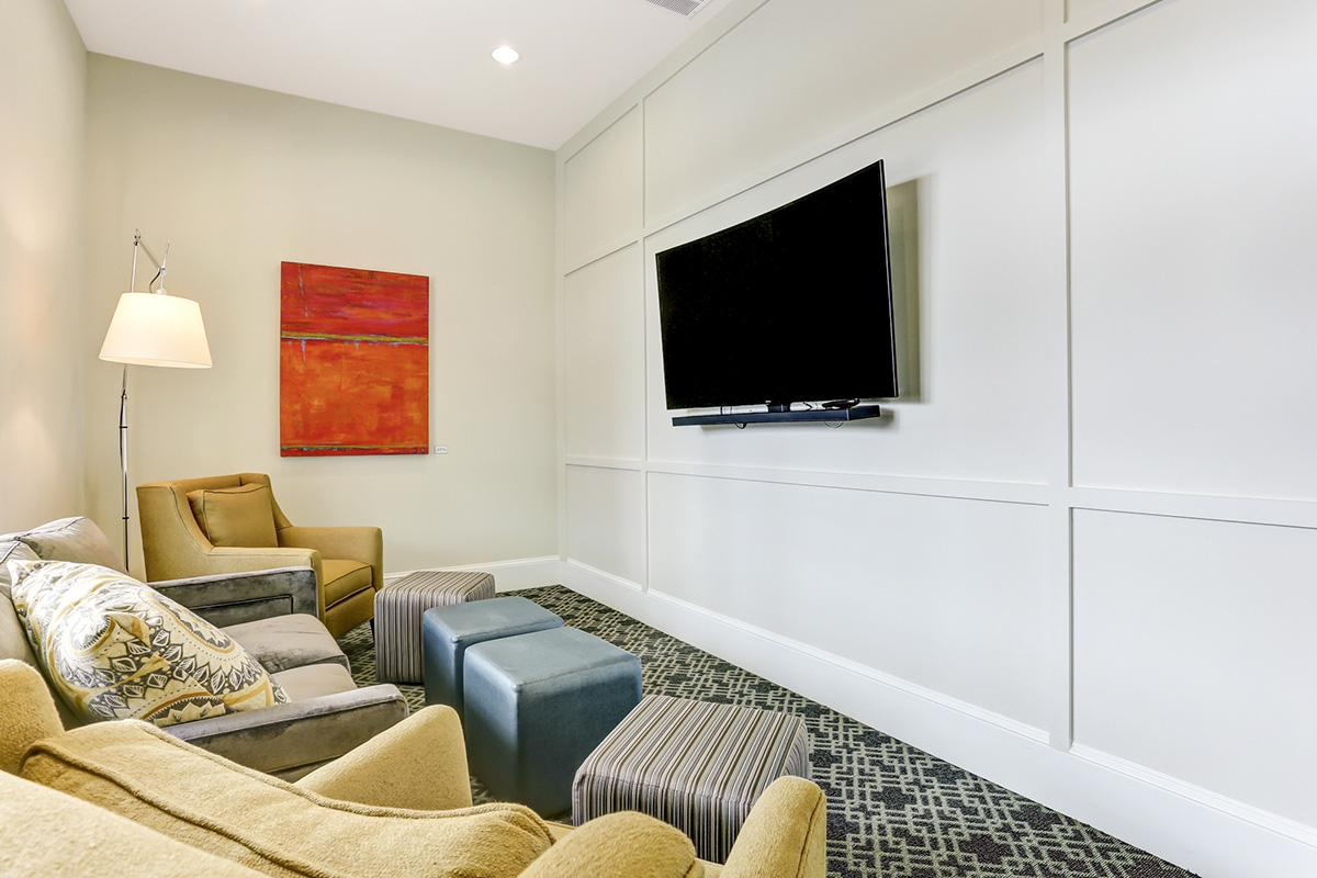 a view of a living room filled with furniture and a flat screen tv