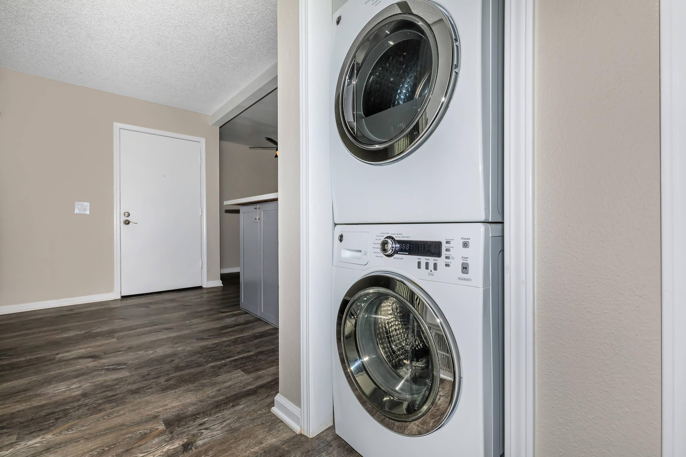 Laundry room at Copper Wood  Apartments in Chino, CA
