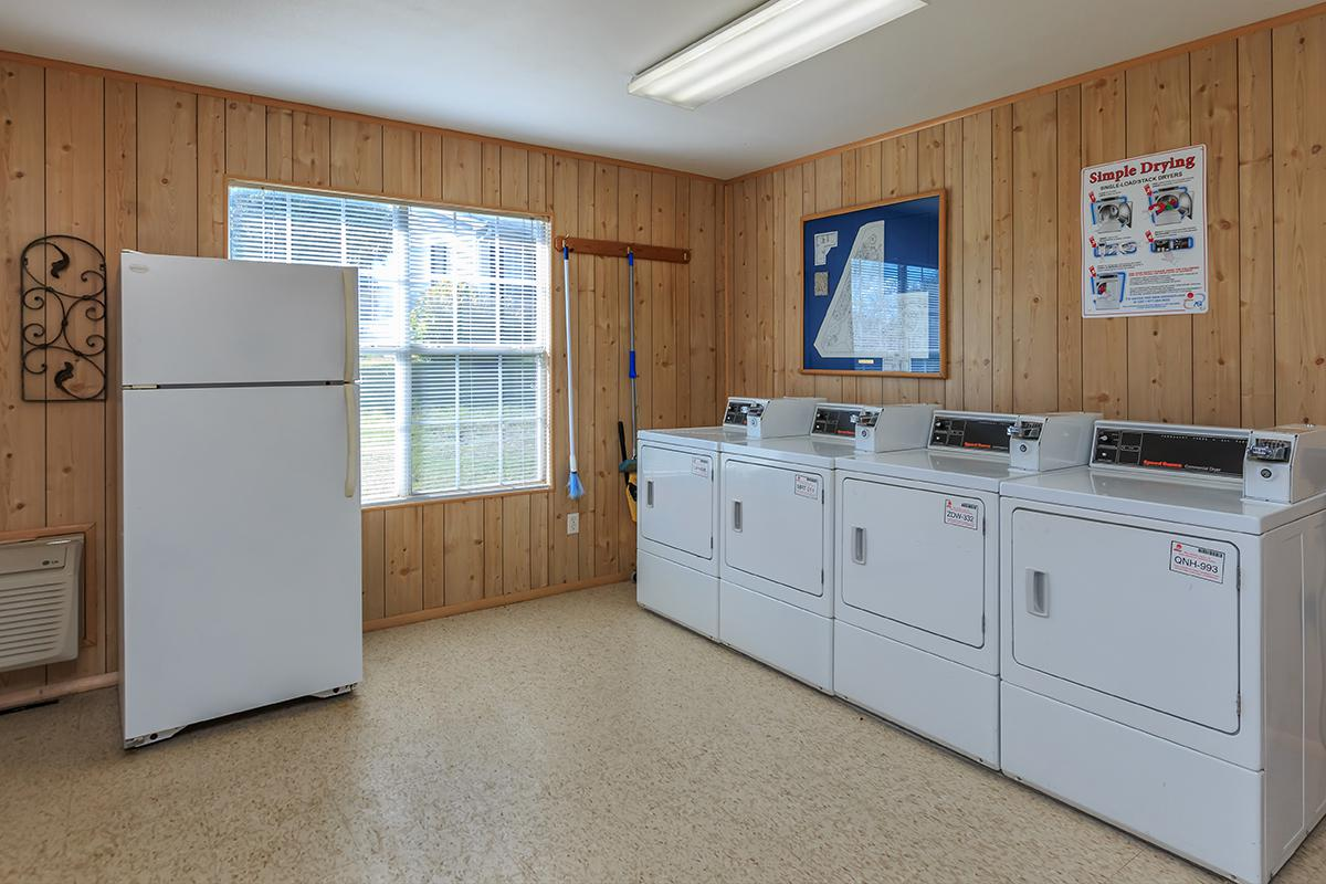 a white refrigerator freezer sitting inside of a kitchen