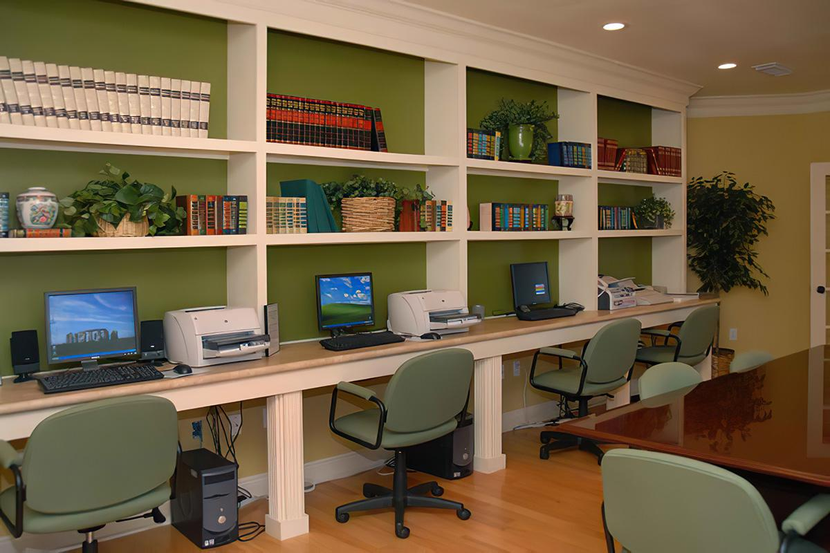a home office with a desk and chair in a room