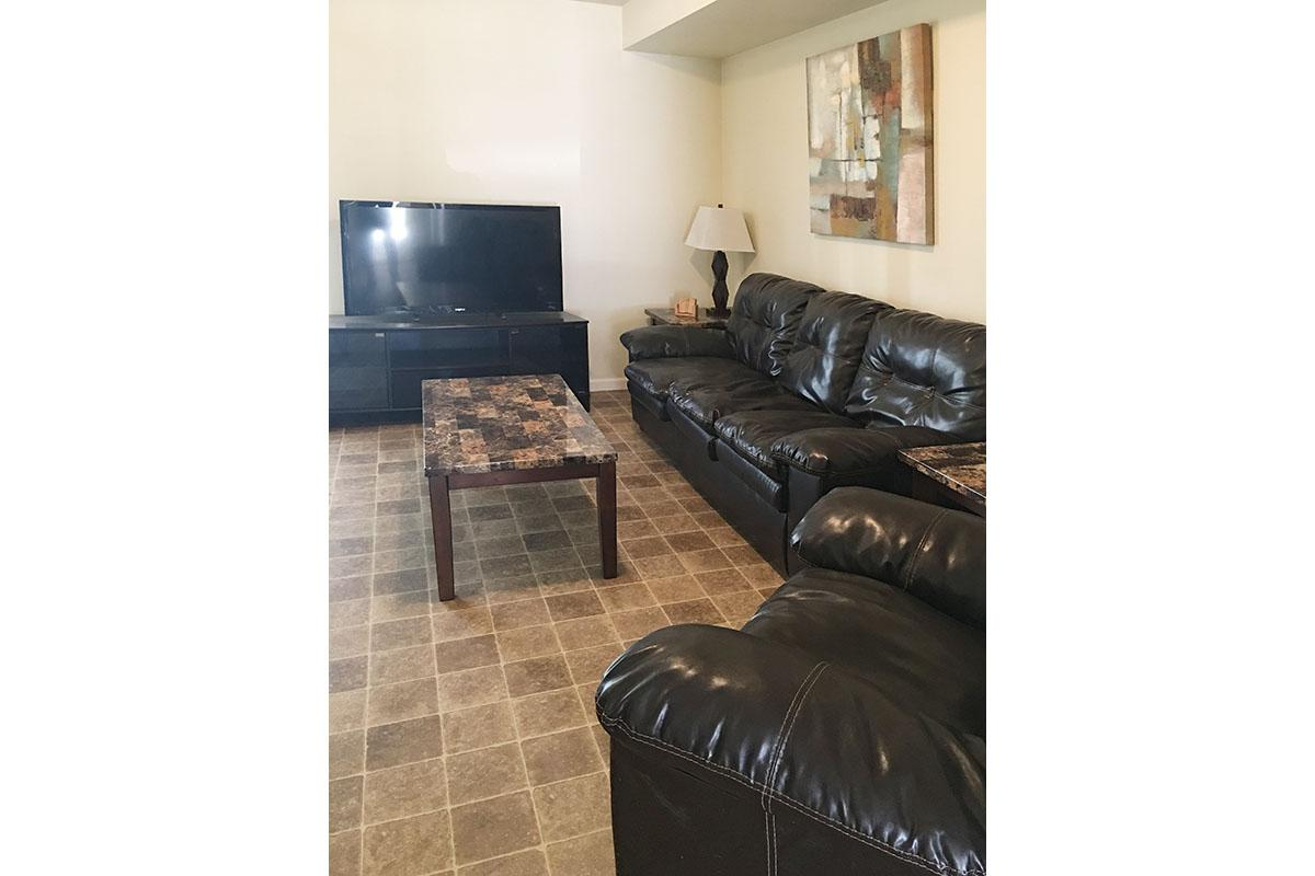 a black leather couch in a living room