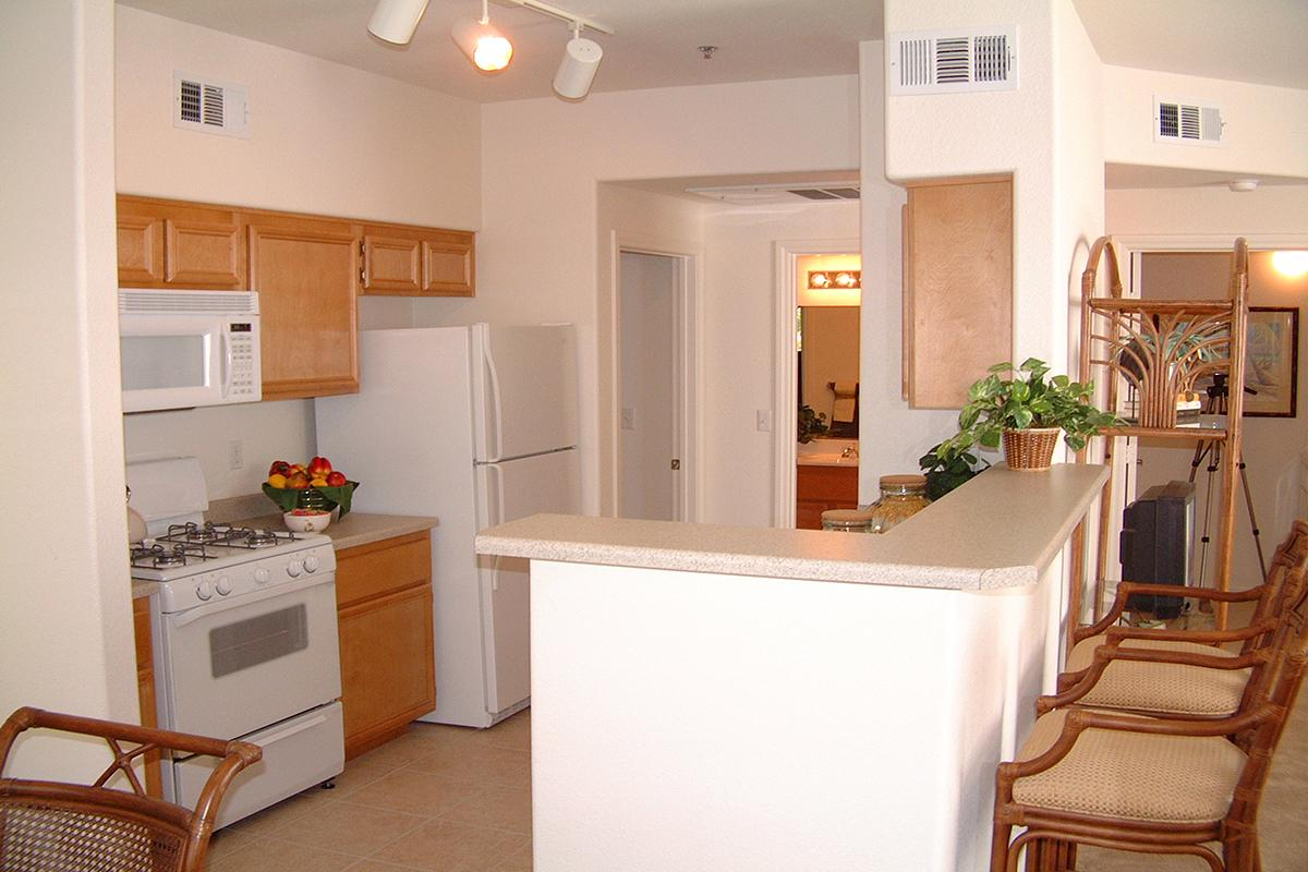 a kitchen with a refrigerator and table in a room
