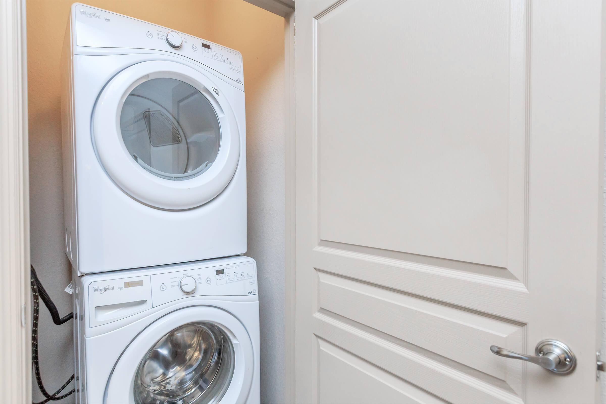 Laundry room at RiZE at Winter Springs Apartments in Winter Springs, FL