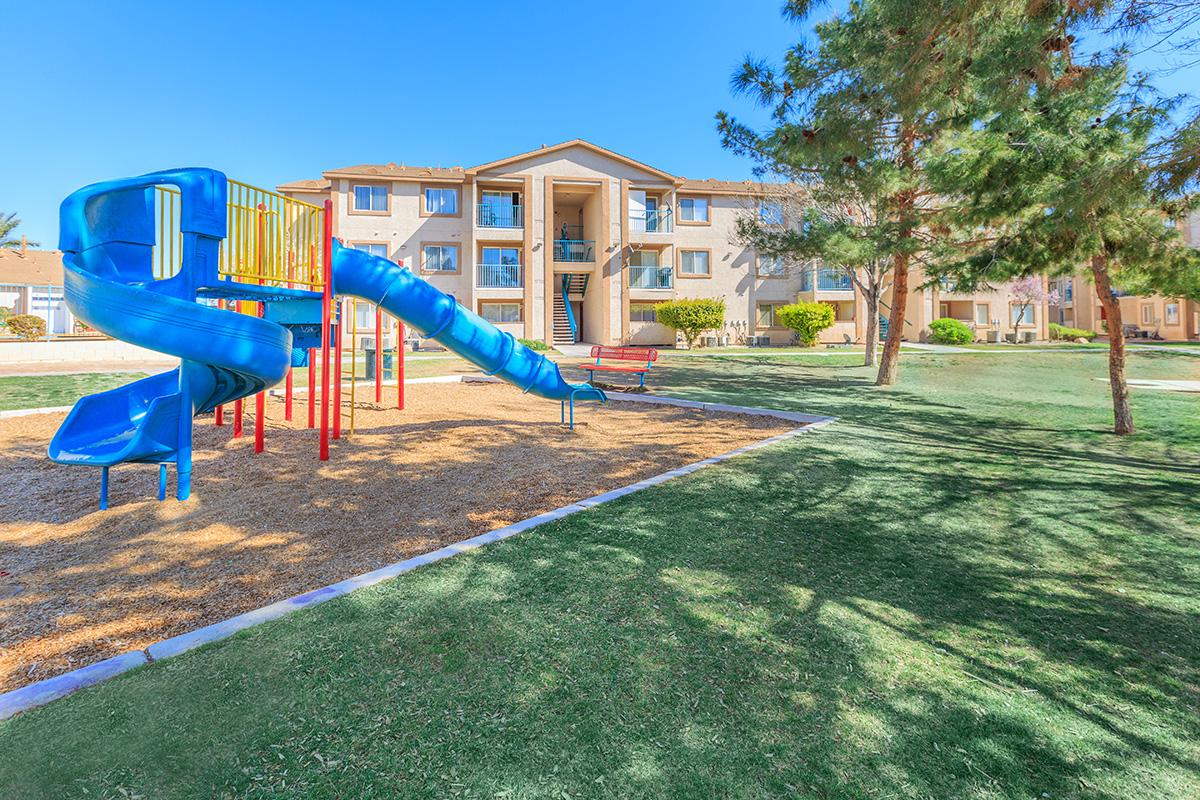 PLAYGROUND SURROUNDED BY MANICURED LAWN AT CHEYENNE POINTE IN LAS VEGAS, NEVADA