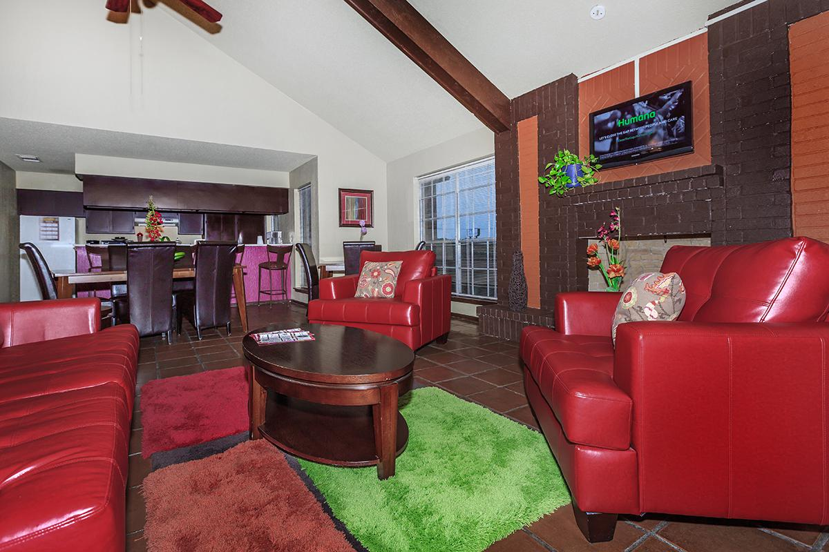 a large red chair in the living room