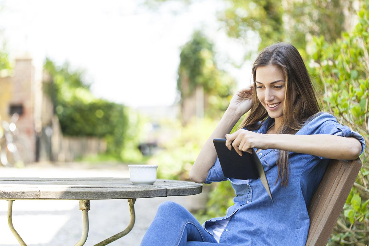 a woman sitting on a bench
