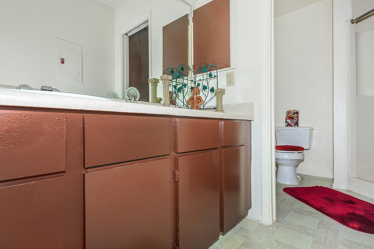 a red cabinet next to a sink