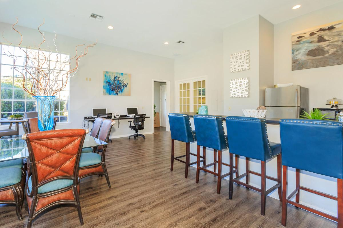 a living room filled with furniture and a blue chair