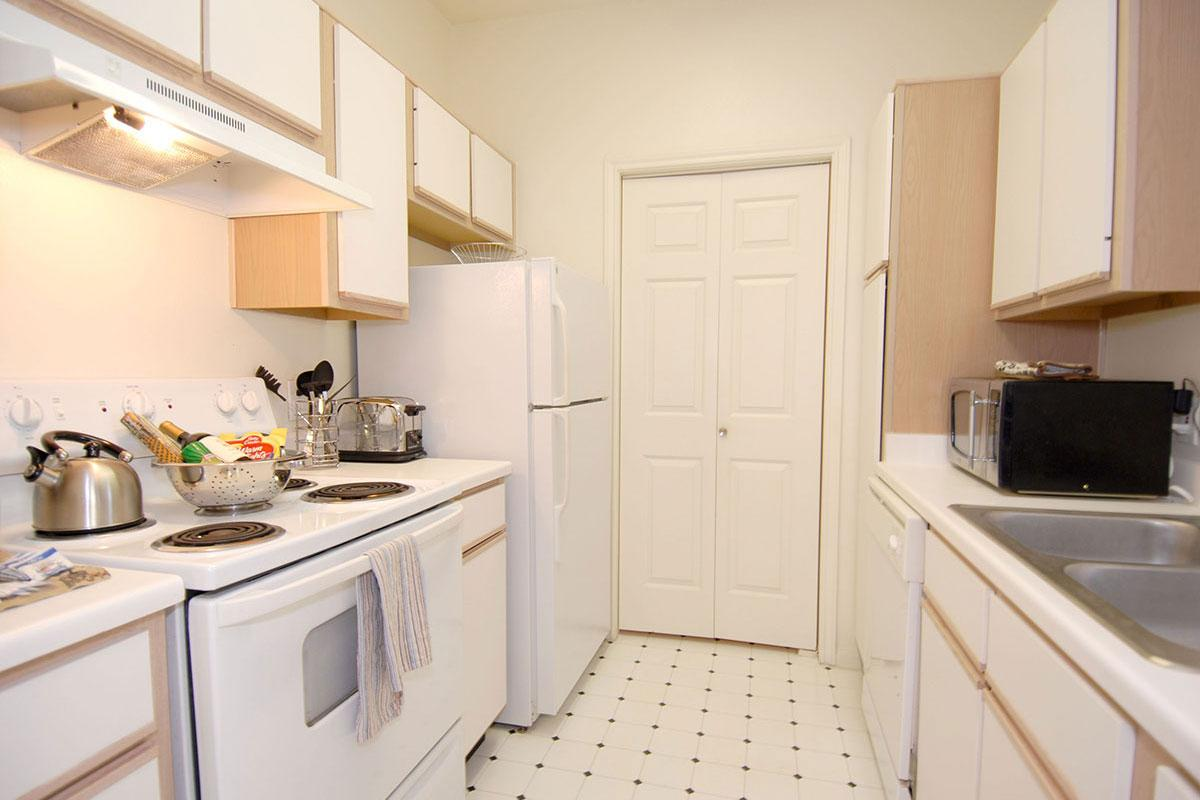 a kitchen with a sink and a microwave