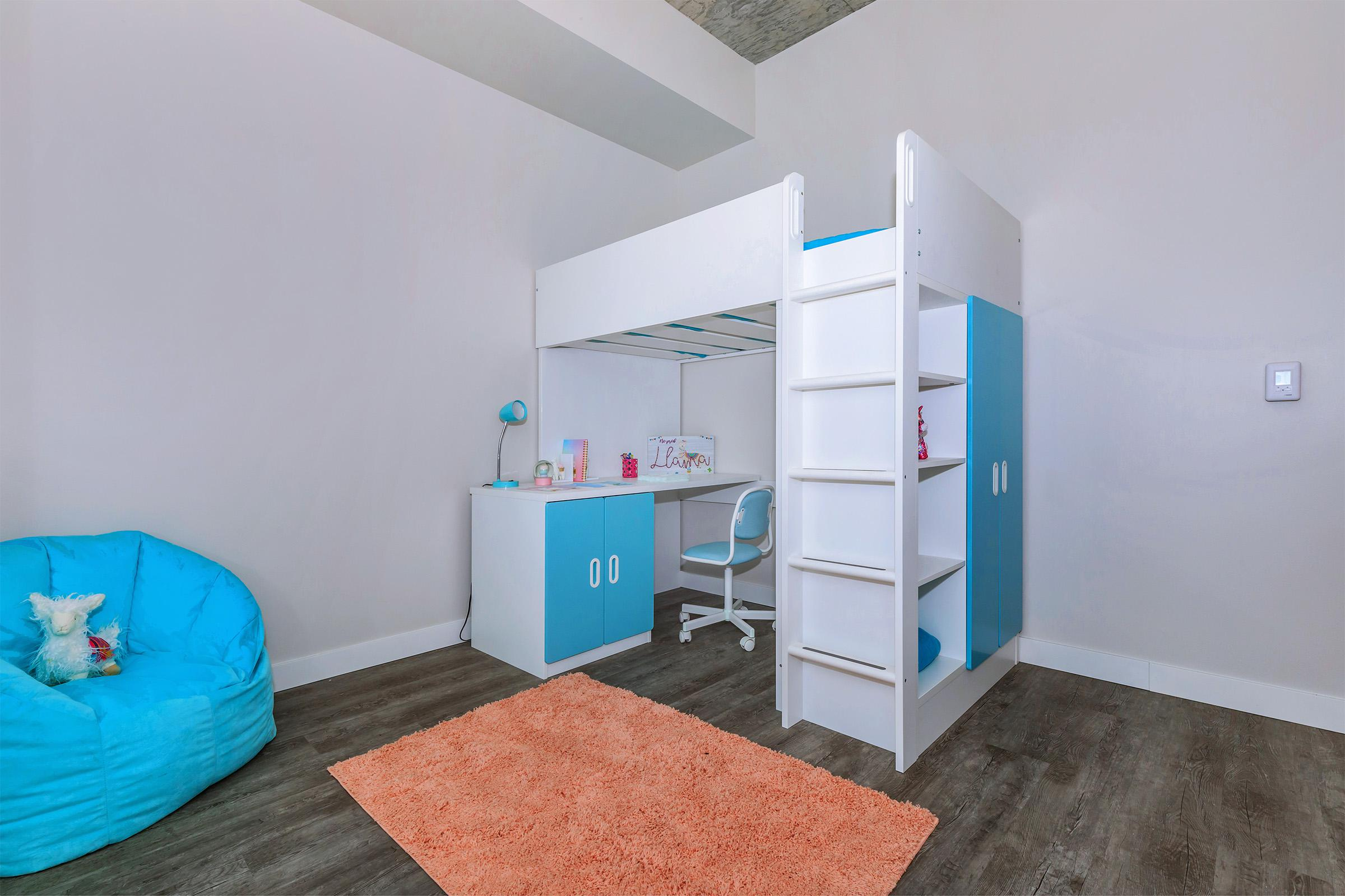 a refrigerator freezer sitting in a room
