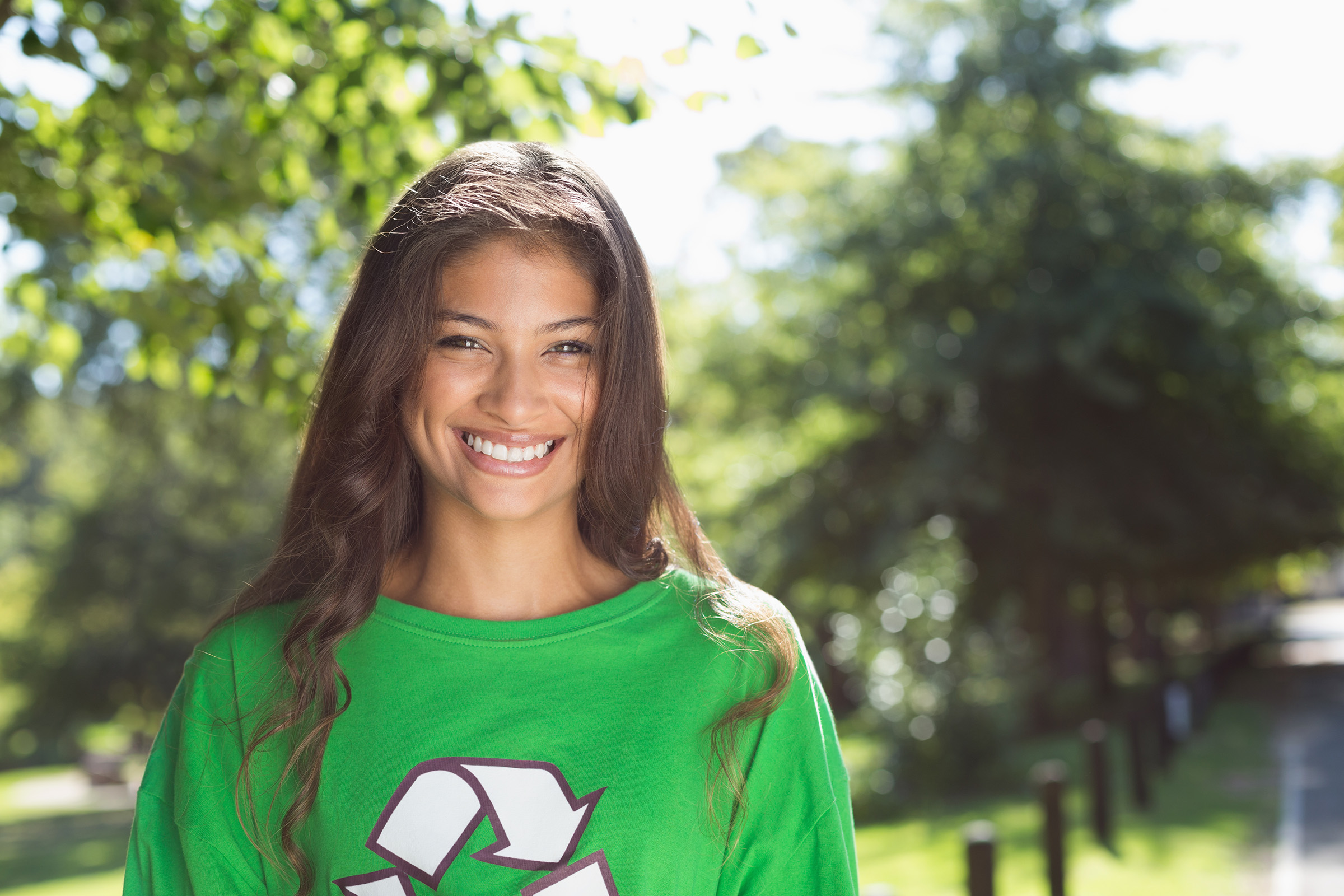 a person wearing a green shirt smiling for a photo