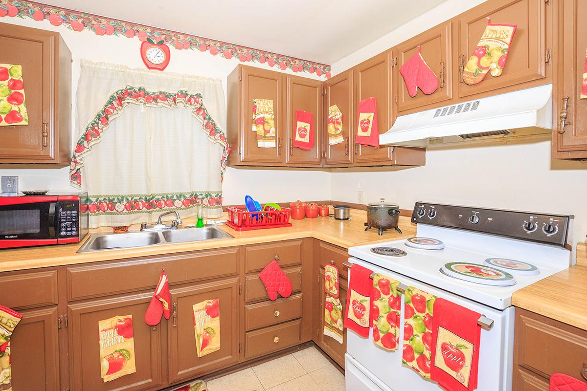 a kitchen with a pink toy