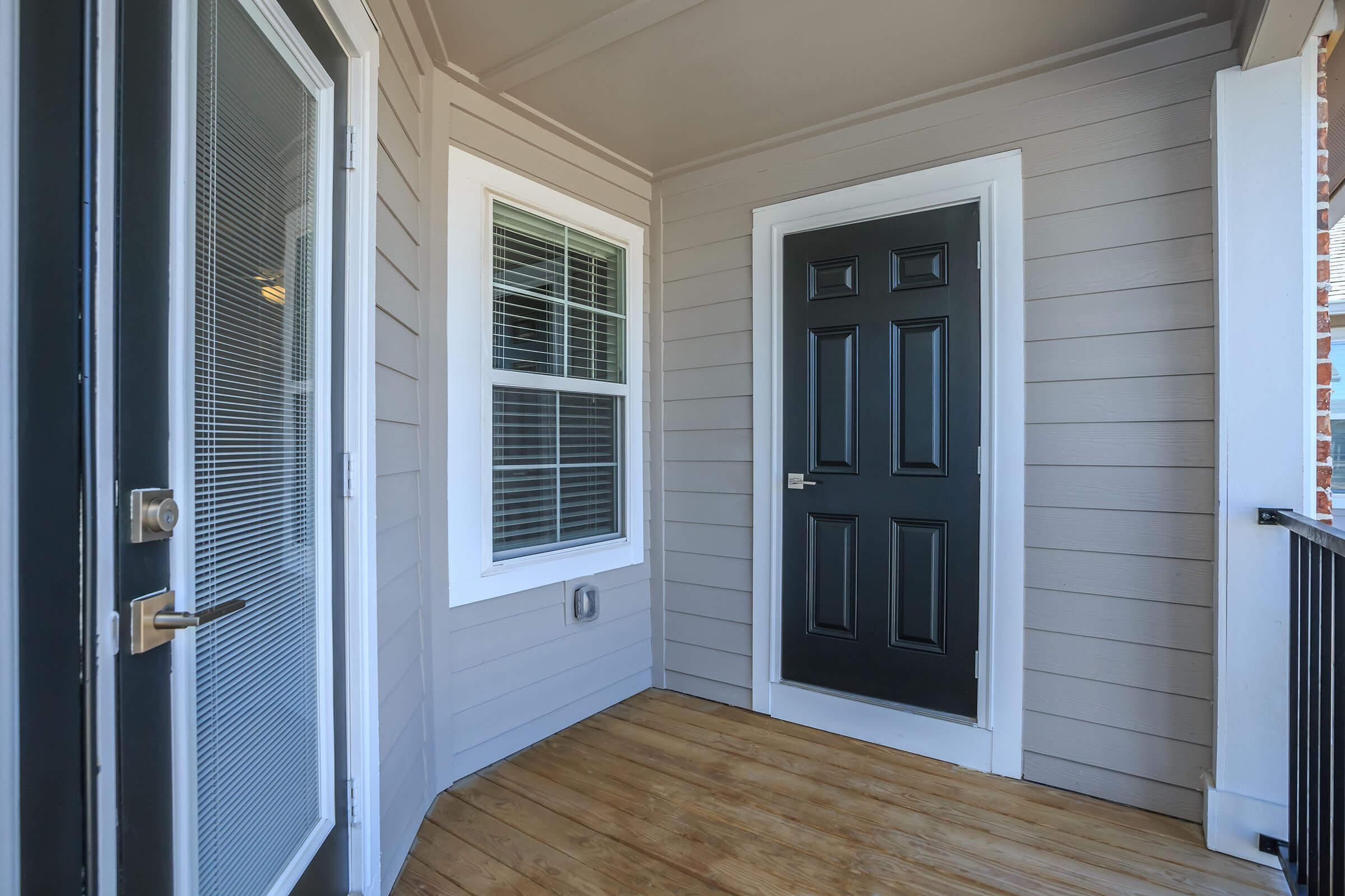 a door with a window in a room