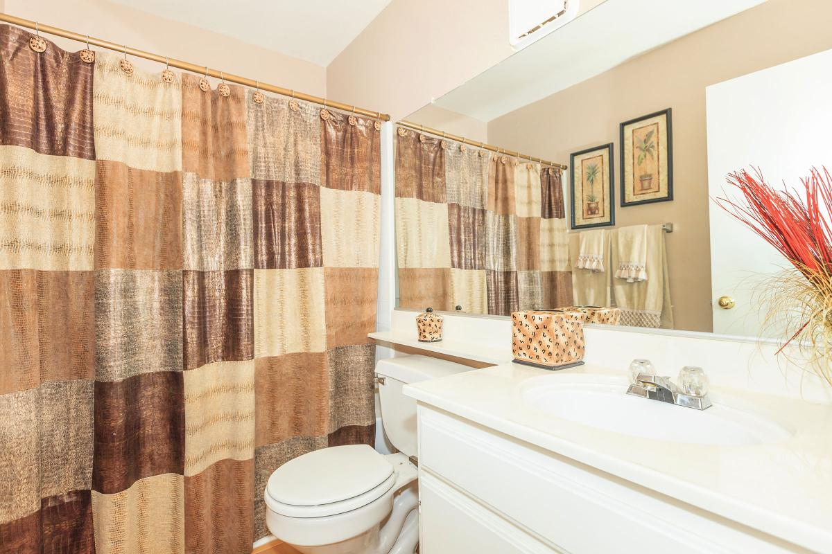 a brown and white shower curtain