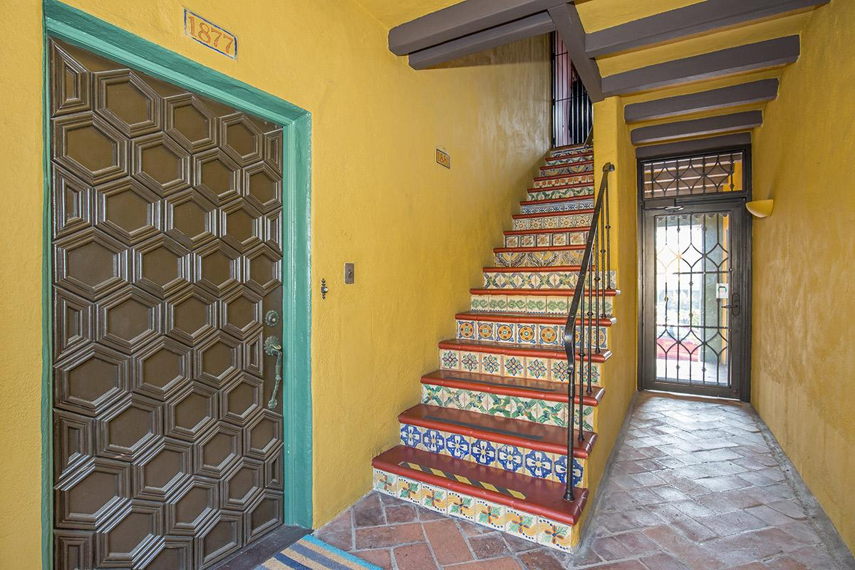 a close up of a yellow building with a tiled floor