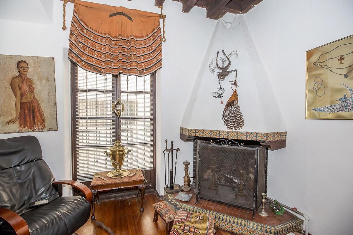 a bedroom with a basket on a table