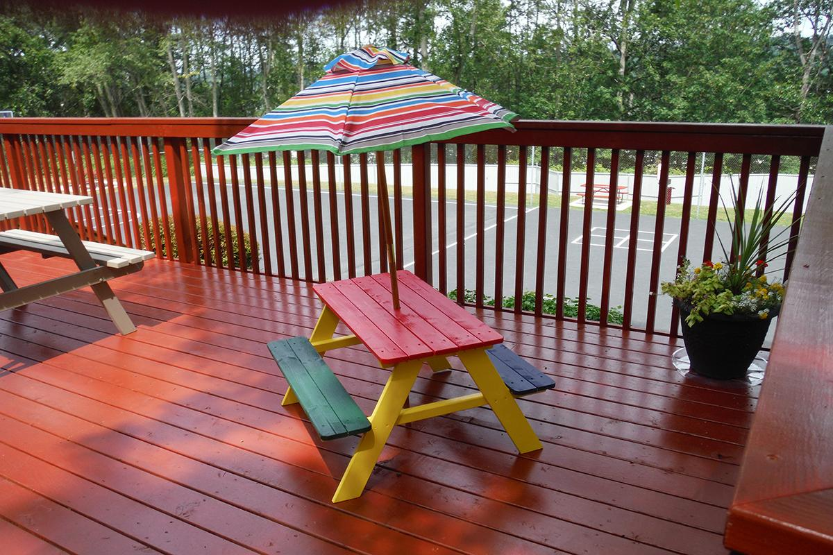 an umbrella sitting on top of a wooden bench