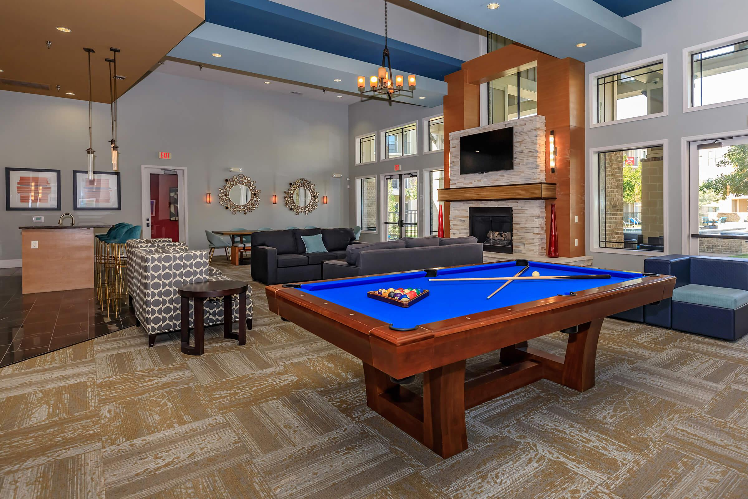 a living room with a pool table