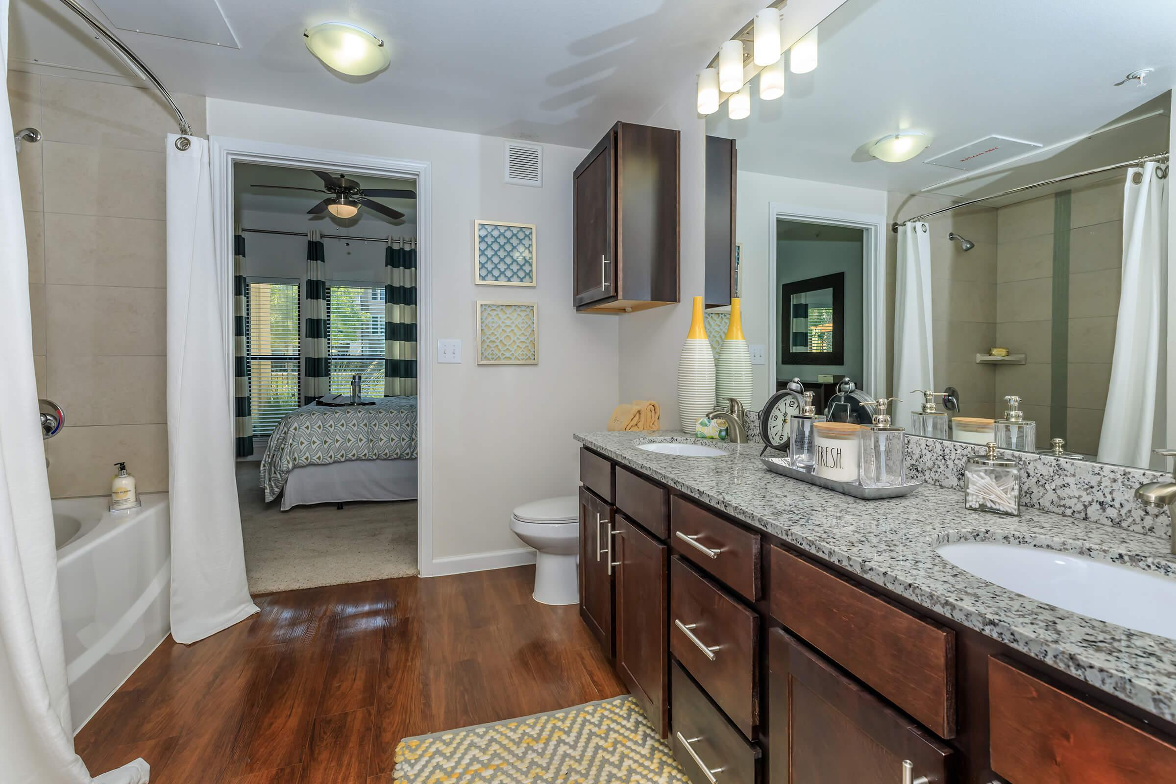 a kitchen with a sink and a mirror