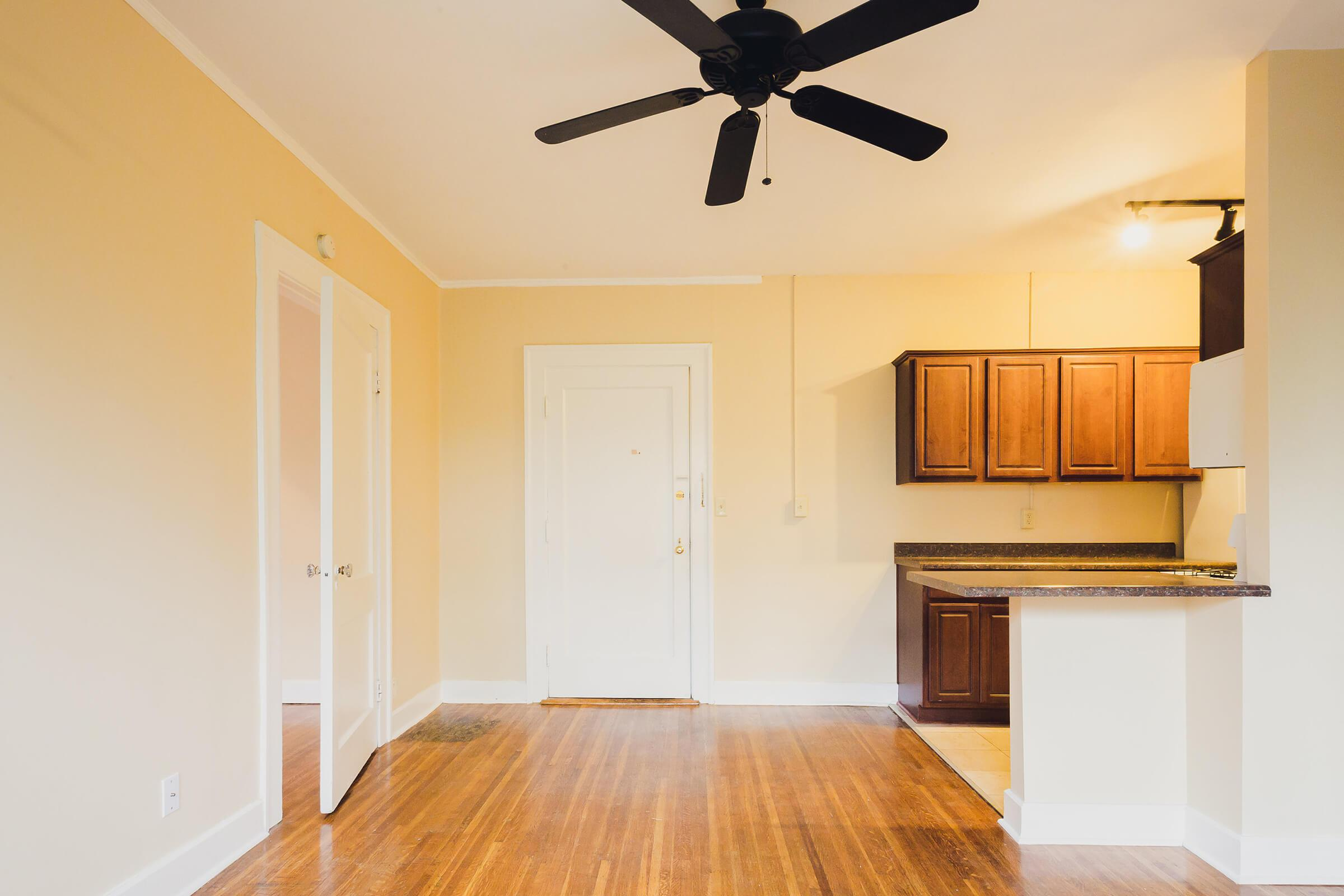 a kitchen with hard wood floors