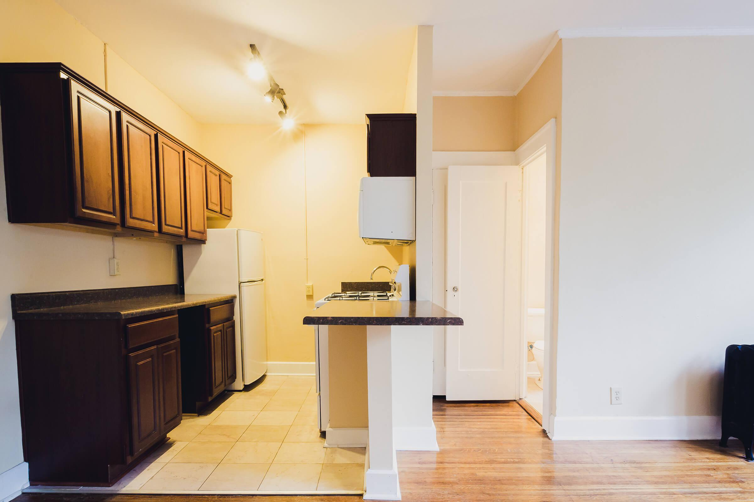 a kitchen with a refrigerator in a room