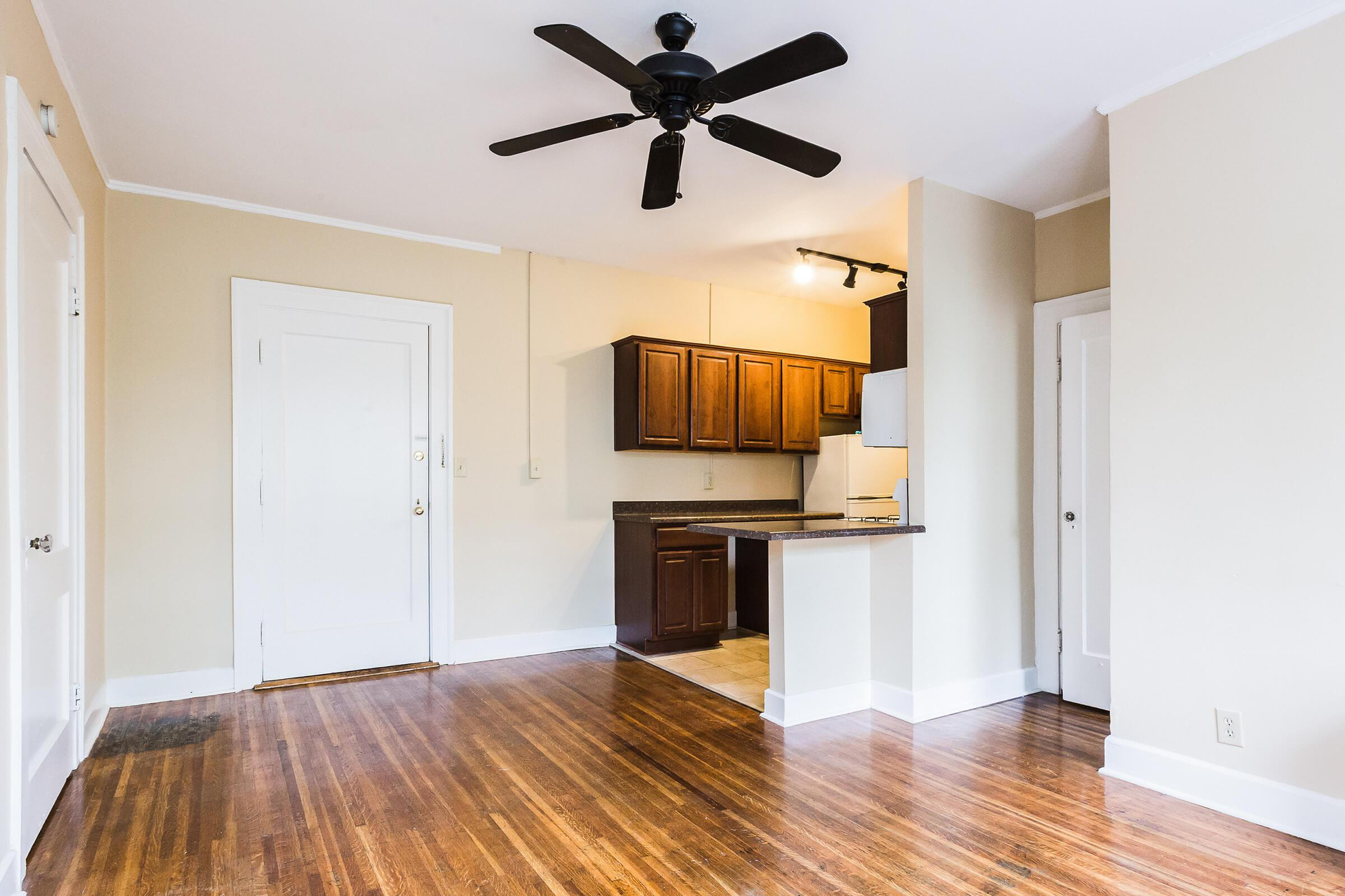 a kitchen with a hard wood floor