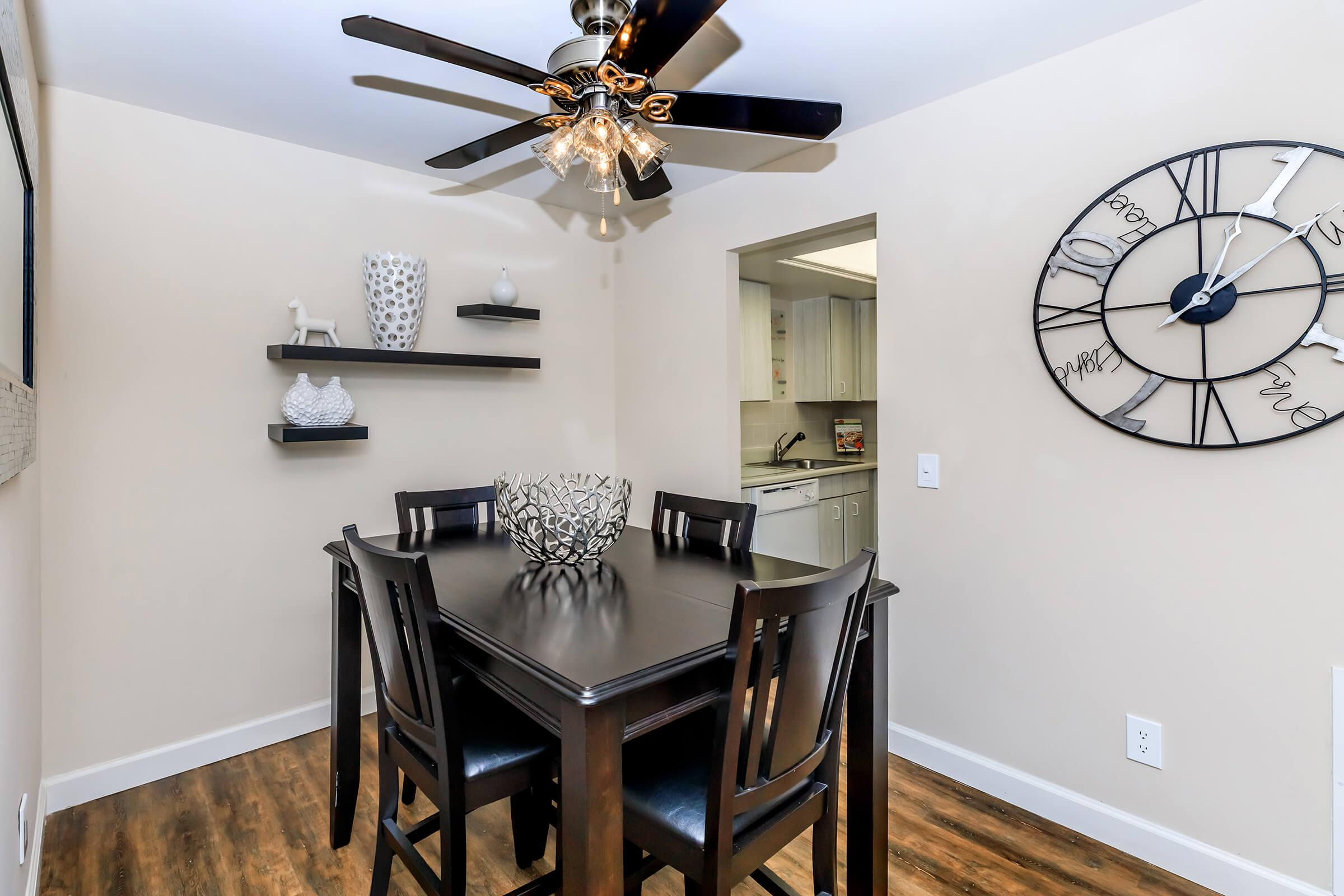 a room that has a clock on a table