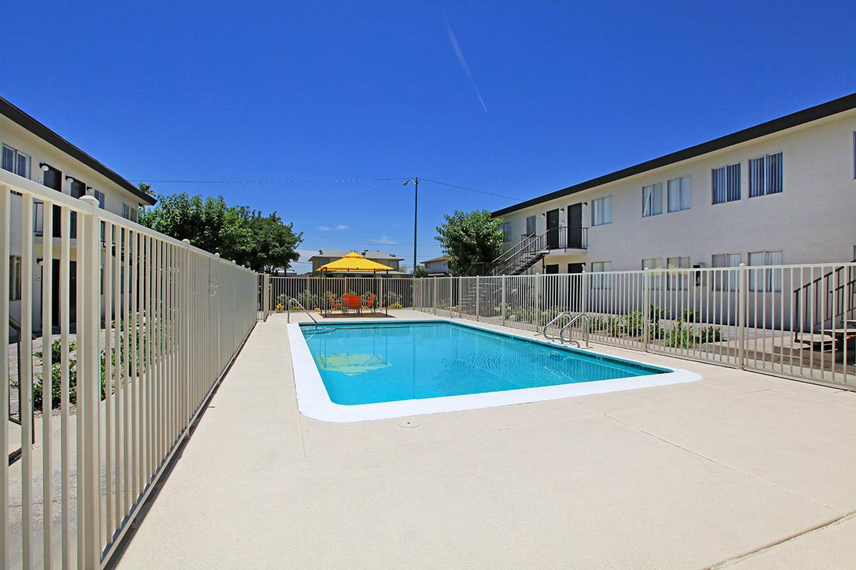 a pool next to a fence