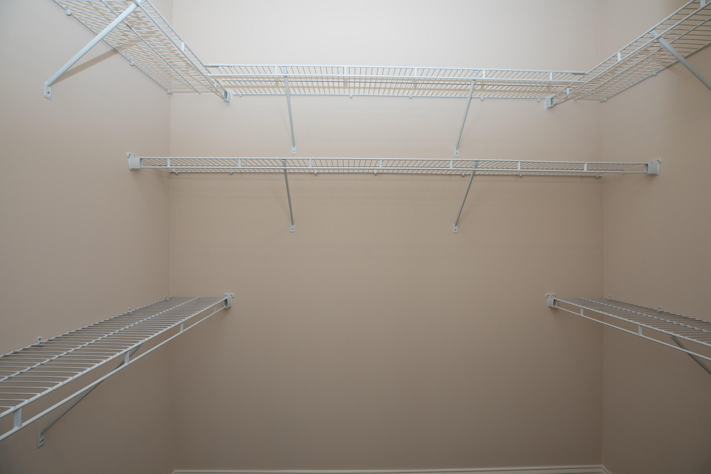 PLENTY OF SPACE IN THE WALK-IN CLOSETS