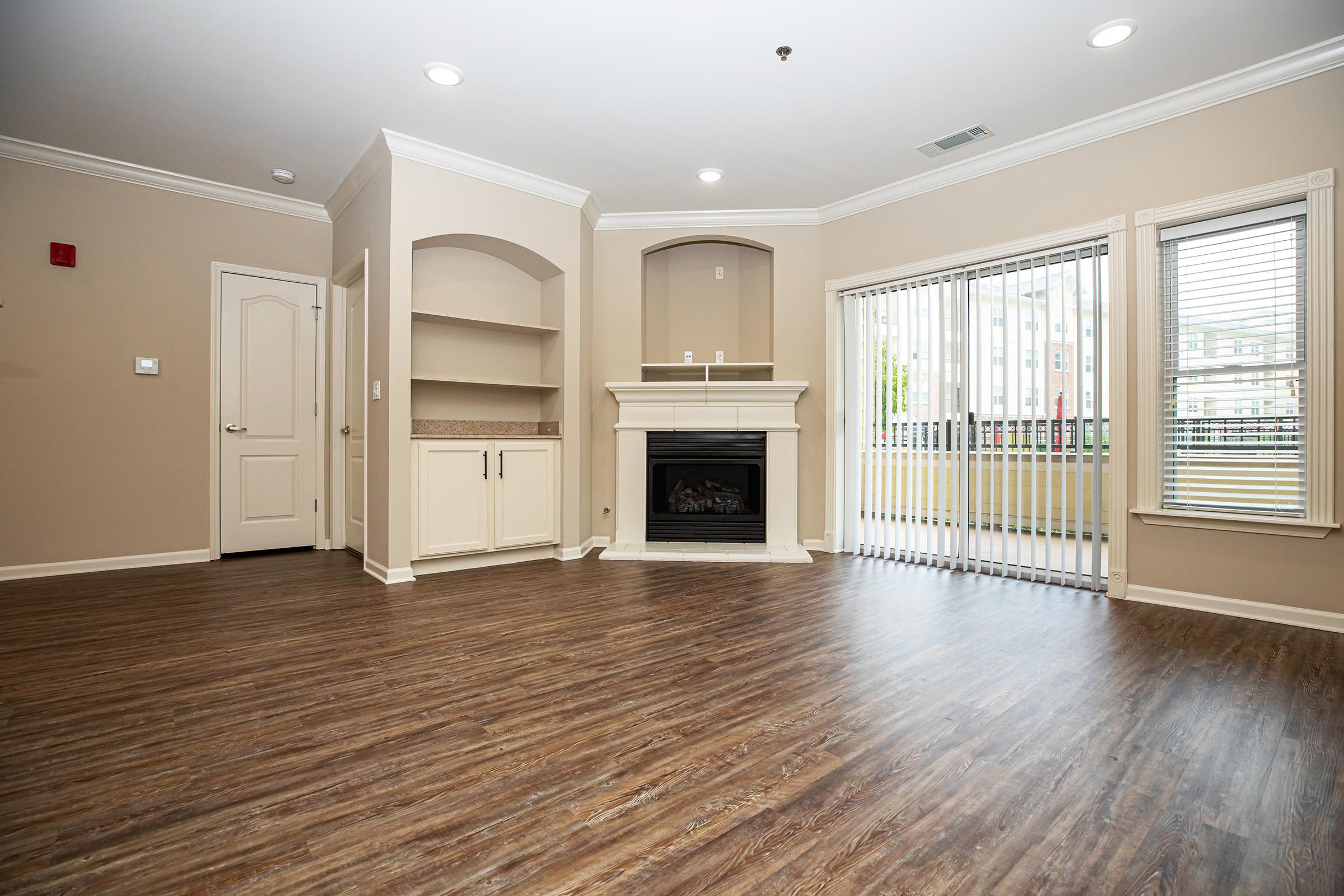 a living room filled with furniture and a flat screen tv