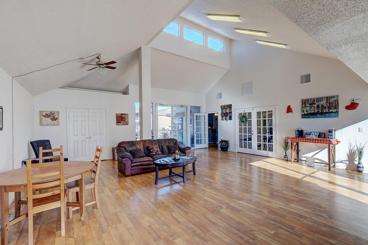 a living room filled with furniture on top of a wooden floor