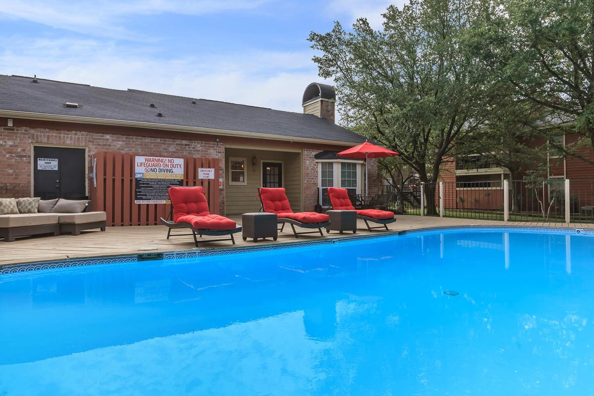 Comfortable lounge seating by the pool at The Park at Summerhill Road