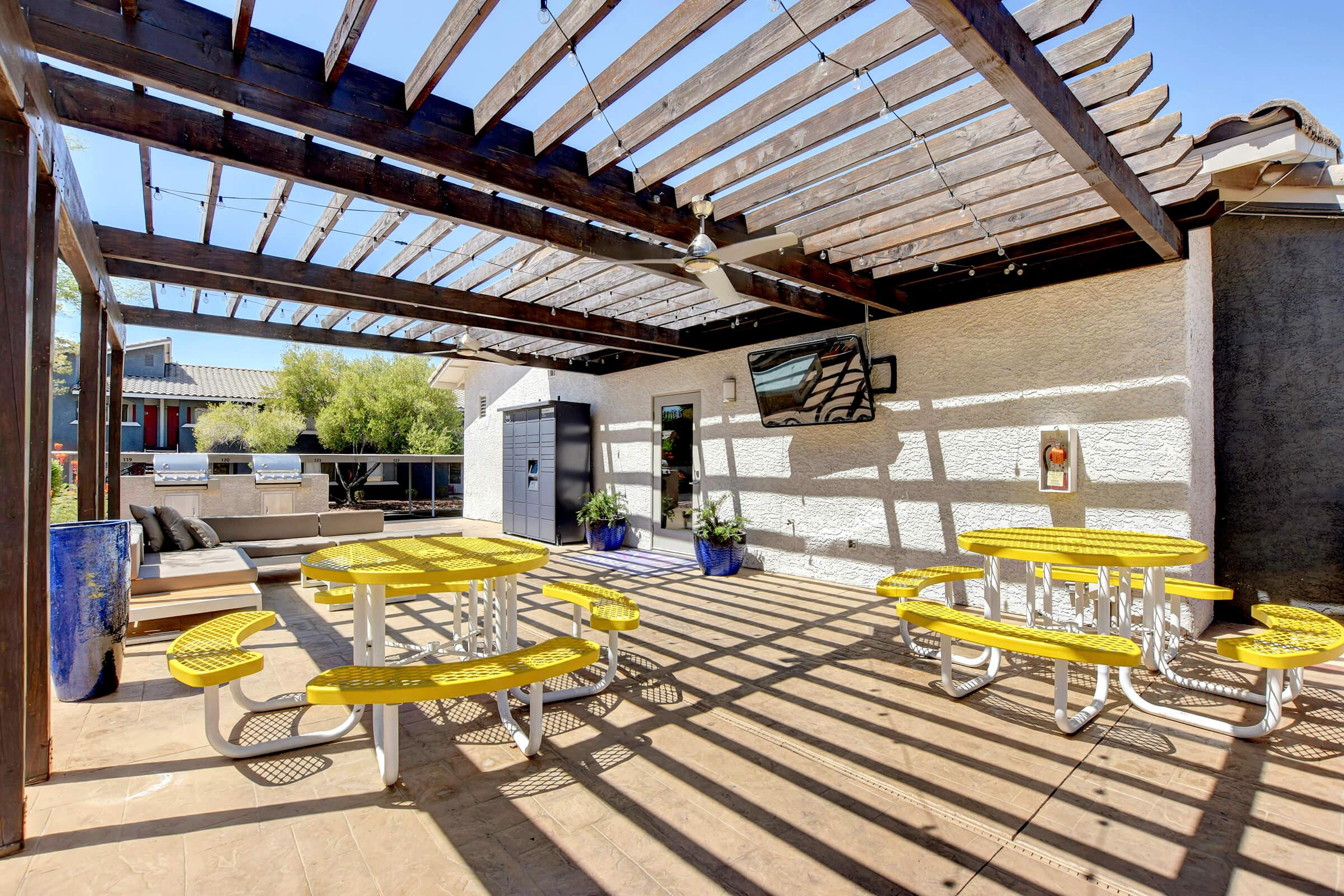 Outdoor Dining Area with TV at Sunset Hills, Henderson, Nevada