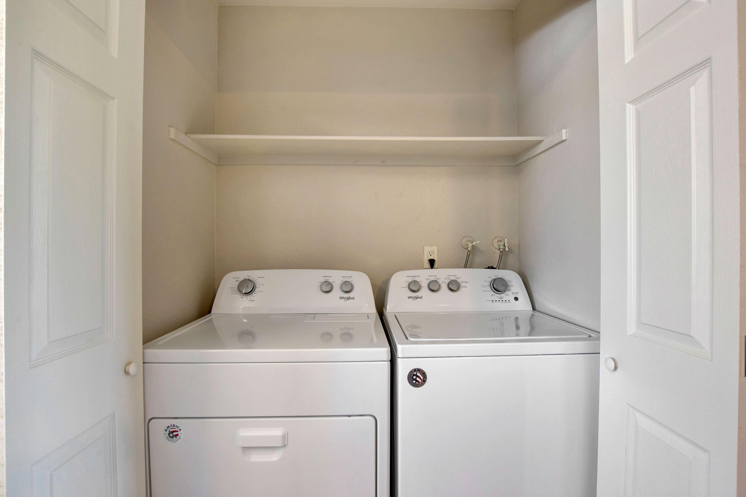 a white refrigerator freezer sitting next to a sink