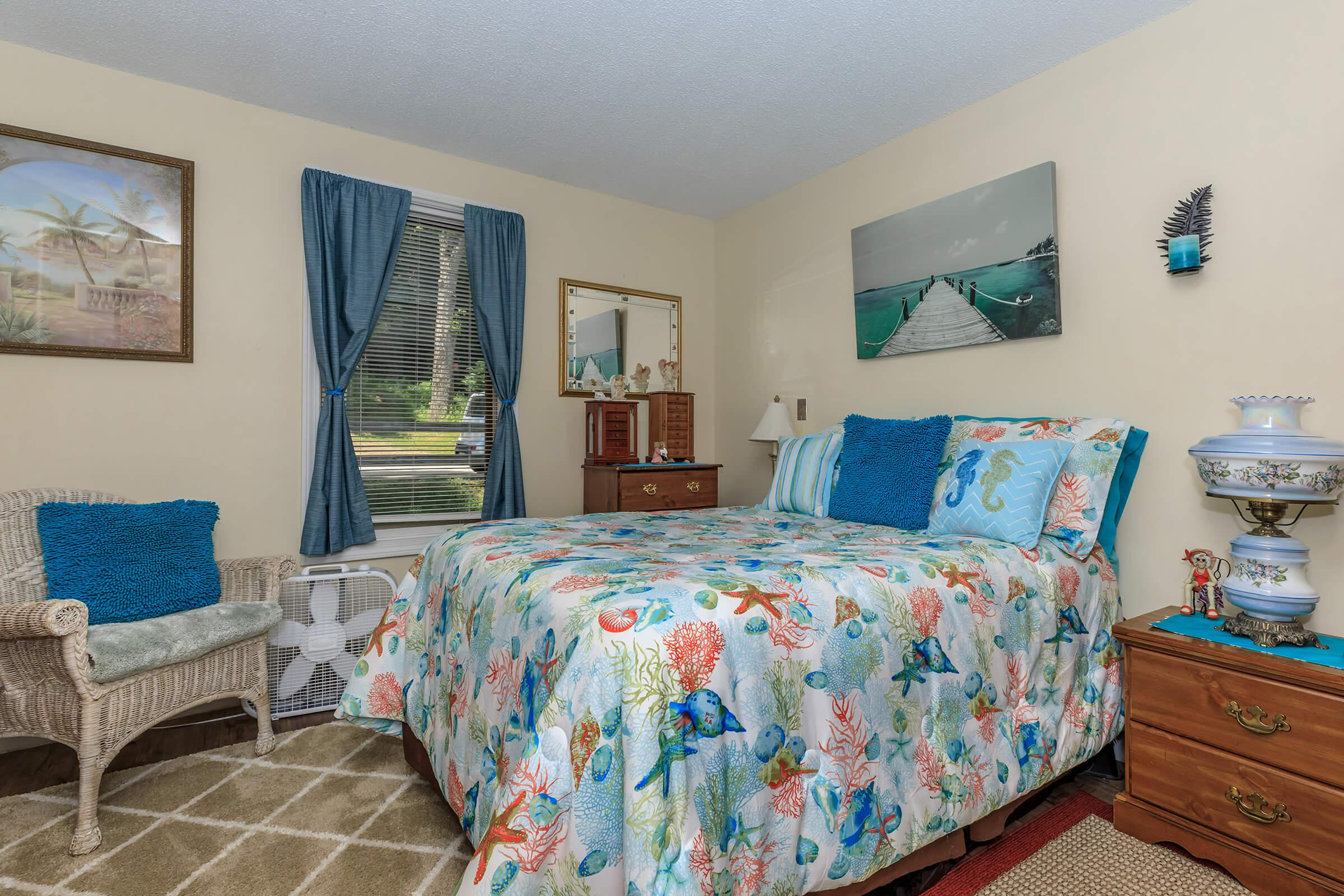 a colorful living room with blue walls and a bed
