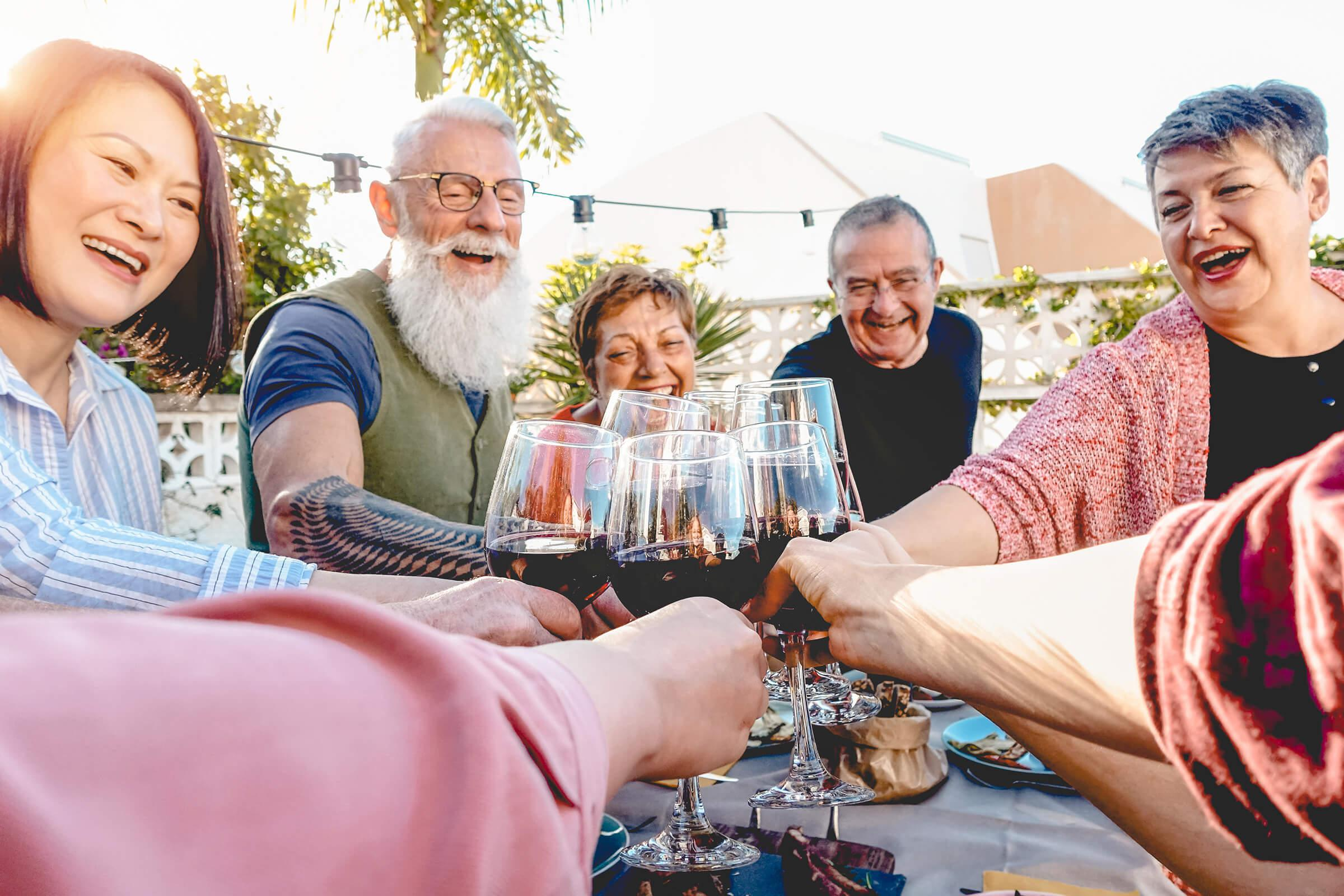 a group of friends drinking wine in our active adult living community
