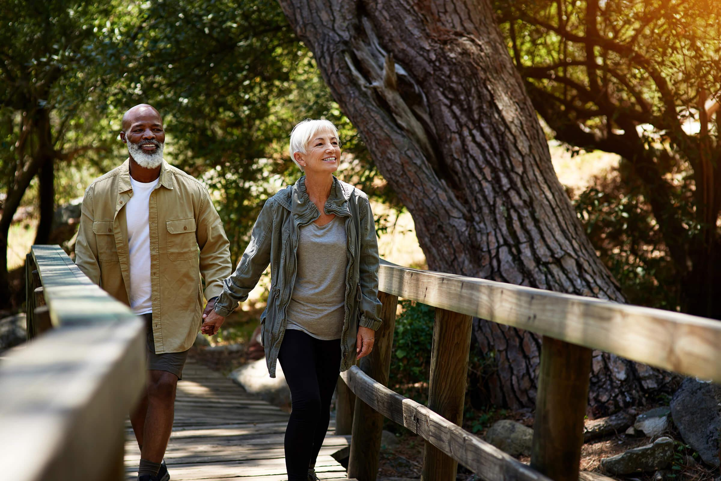 a couple taking a walk from our active adult living community