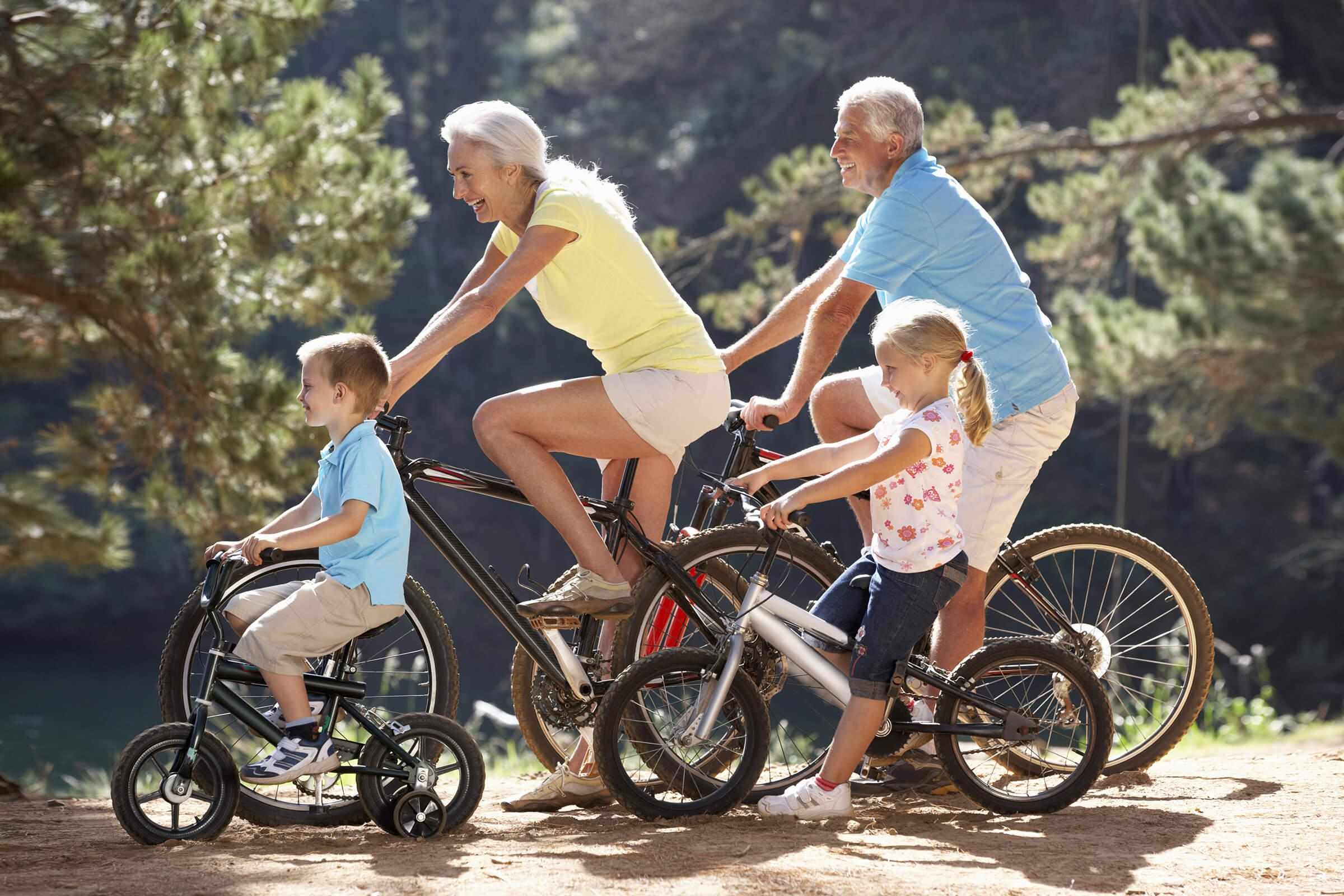 a family riding bikes from our active adult living community