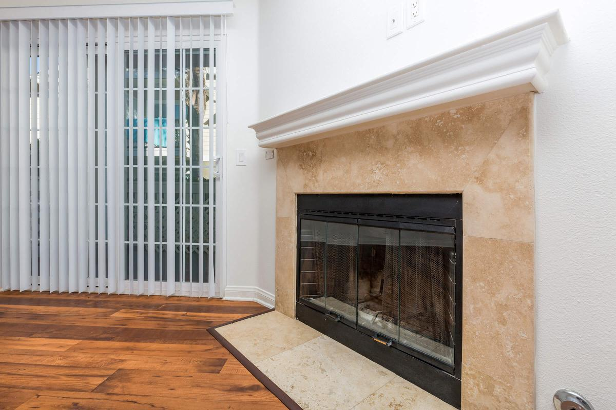 a door with a window and a fireplace