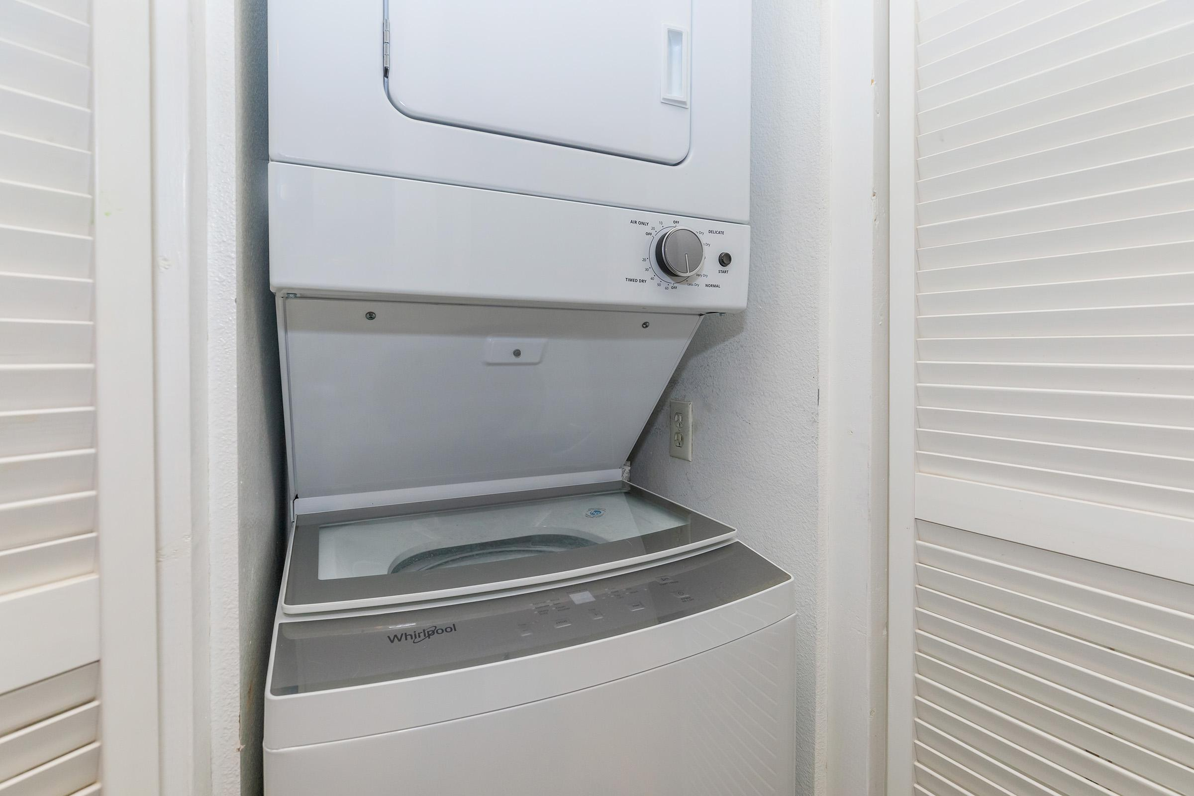 a white stove top oven sitting next to a door