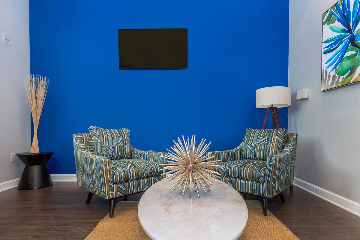 a table topped with a blue chair