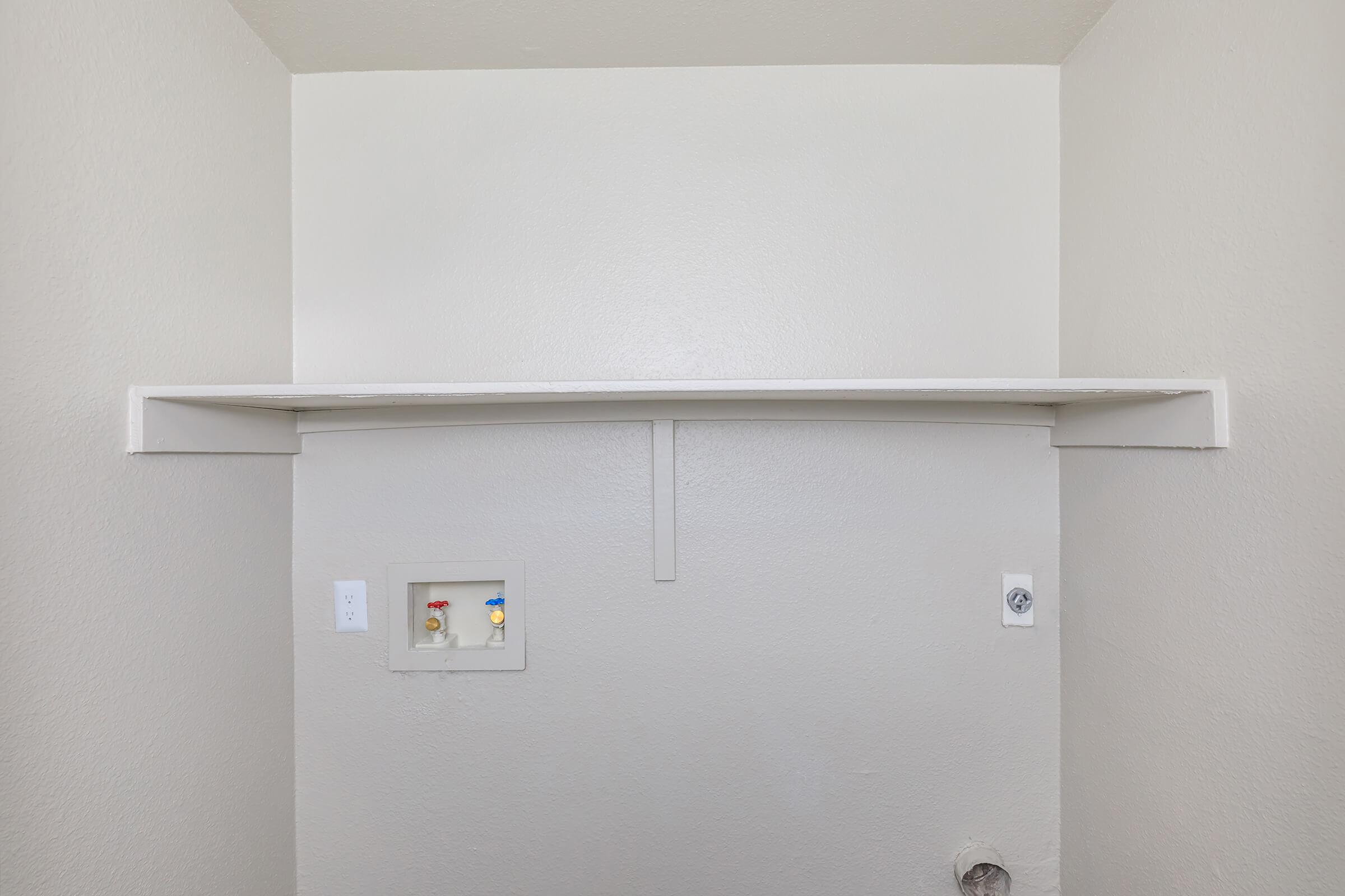 a white refrigerator freezer sitting inside of a building